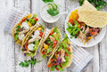 Mexican tacos with chicken, black beans and fresh vegetables and tartar sauce Royalty Free Stock Photo