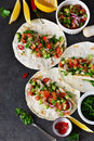 Mexican tacos with filling and guacamole sauce