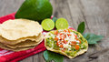 Mexican tostadas with avocado and lemon on wooden background Stock Image