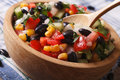 Mexican vegetable salad macro in a wooden plate. horizontal Royalty Free Stock Photo