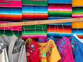 Mexican wooven sarapes and dresses traditional market wool Royalty Free Stock Images