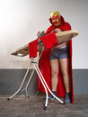 Mexican wrestler ironing his tights photograph of a or luchador red before fight Royalty Free Stock Photography