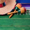 Mexico cinco de mayo wood background border mexican sombrero maraca Royalty Free Stock Photo