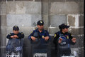 Mexico City, Mexico - November 24, 2015: Three Mexican Police Officers in Riot Gear outside building in Zocalo Square, Mexico City Royalty Free Stock Photo