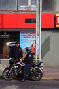 Mexico city mexico november two mexican police officers federal police one on motorbike talking to the other outside a shop Royalty Free Stock Photos