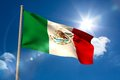 Mexico national flag on flagpole blue sky background Royalty Free Stock Image