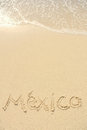 Mexico Written in Sand on Beach Stock Images