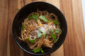 Meyer lemon spaghetti caramelized with toasted garlic breadcrumbs and parmesan cheese garnished with parsley Stock Image