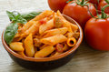 Mezze penne with tomato sauce and pork sausage Royalty Free Stock Images
