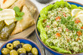 Mezze selection of middle eastern dishes tabbouleh falafel olives sarma spinach borek fatayer hummus and pita bread Royalty Free Stock Photos