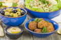 Mezze selection of middle eastern dishes tabbouleh falafel olives sarma spinach borek fatayer hummus and pita bread Royalty Free Stock Photo