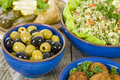 Mezze selection of middle eastern dishes tabbouleh falafel olives sarma spinach borek fatayer hummus and pita bread Royalty Free Stock Images