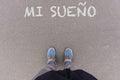 Mi sueno, Spanish text for My Dream text on asphalt ground, feet