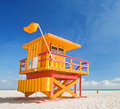 Miami beach florida lifeguard house in a typical colorful art deco style on a sunny summer day with blue sky and atlantic ocean in Stock Images