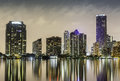 Miami downtown at night illuminated by business and luxury residential buildings in florida Royalty Free Stock Photos