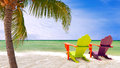 Miami florida panorama of colorful lounge chairs at a tropical paradise beach in beautiful aqua green waters the ocean hanging Stock Image