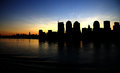Miami silhouette sun setting behind the cityscape Royalty Free Stock Photos