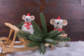 Mice with christmas tree on wooden wheelbarrow two are transporting a for a snow and background Stock Images