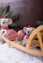 Mice get christmas apples with wheelbarrow in snow before a dark colored wooden background Stock Image