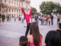 Michael jackson tribute artist finishes a number on the plaza in young man red shirt and black jeans ends street performance place Stock Photos
