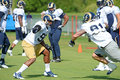 Michael sam and chris long during rams practice august earth city missouri usa st louis defensive end goes up against afternoon at Stock Photo