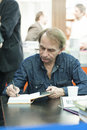 Michel houellebecq award winning french author dedicating controversial and filmmaker and poet his books as guest of honour of th Stock Photos