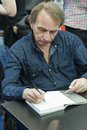 Michel houellebecq award winning french author dedicating controversial and filmmaker and poet his books as guest of honour of th Royalty Free Stock Photography