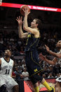 Michigan guard Nik Stauskas. goes up for a shot Stock Photo