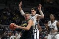 Michigan s mitch mcgary tries to get shot off as penn state s sasa borovnjak defends Stock Photos
