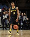 Michigan s trey burke dribbles the basketball Royalty Free Stock Image