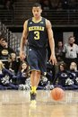 Michigan s trey burke dribbles the basketball Stock Photography