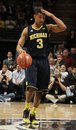 Michigan s trey burke signals the play against penn state Stock Images