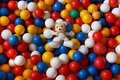 Mickey mouse sits on a background of colorful balls