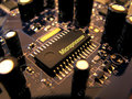 Microchip on the PCB with capacitors Royalty Free Stock Photo