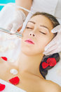 Microdermabrasion treatment young woman receiving spa Royalty Free Stock Photography