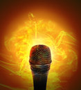 Microhone has fire smoke around orange background music entertainment concept Royalty Free Stock Photos