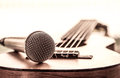 Microphone on acoustic guitar in vintage color tone Royalty Free Stock Photos