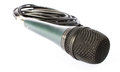 Microphone with black wire isolated on white photo of Royalty Free Stock Photos