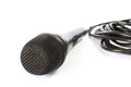 Microphone with black wire on white photo of Stock Photo