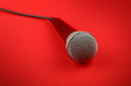 Microphone with cable high angle close up over red Royalty Free Stock Photo
