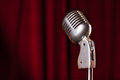 Microphone closeup on red background Royalty Free Stock Photos
