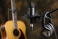 Microphone, earphones and acoustic guitar Royalty Free Stock Photo