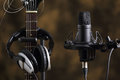 Microphone, earphones and electric guitar Royalty Free Stock Photo