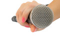 Microphone in a hand on white background Stock Image