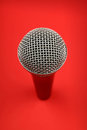 Microphone high angle close up over red Royalty Free Stock Photo