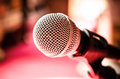 Microphone in karaoke room or conference room close up of front of pink background music Stock Photos