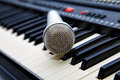 The microphone lies on the synthesizer Royalty Free Stock Photo