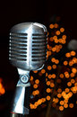 Microphone and lights nice old with some christmas in the background Royalty Free Stock Photos