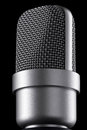 Microphone macro on the black background Royalty Free Stock Photo