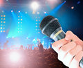 Microphone in male hand Royalty Free Stock Photography